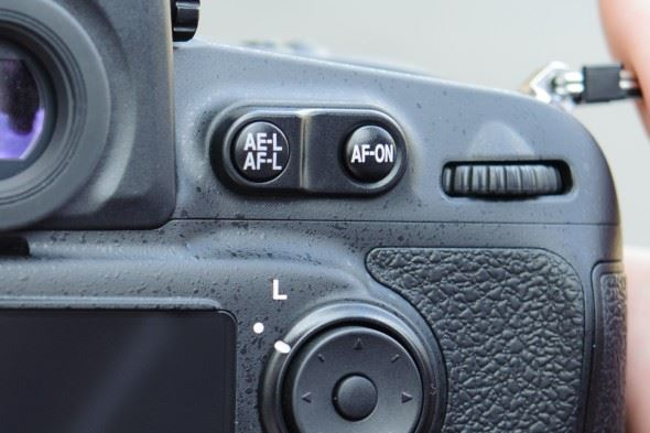 You can activate autofocus with your camera's AF-On control, rather than the shutter-release button.