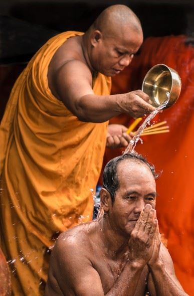 Dedicated flashguns have a greater power output, and many more adjustment options. A quick burst of flash outdoors can help to freeze the action, as with this Buddhist ceremony in Cambodia