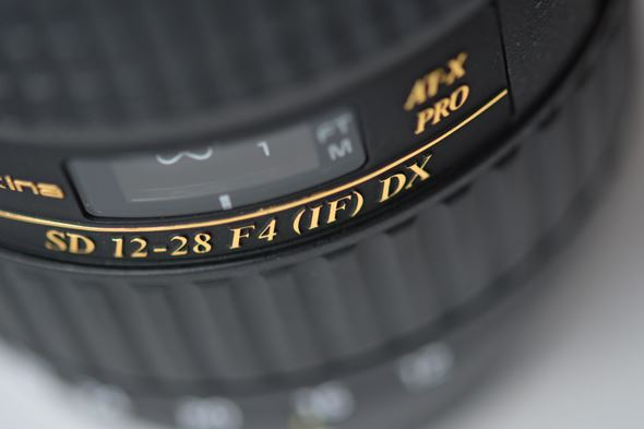Lenses with internal focus sometimes have the symbol IF inscribed on their barrel.