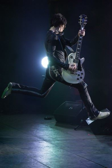Justin Hawkins of the Darkness mid-jump at HOG Festival